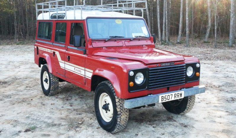 big red land rover defender 110 – relic imports | land rover